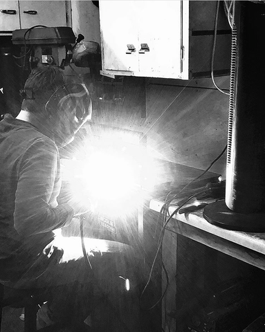 David Welding a Stove in his Workshop