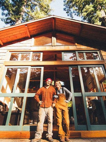 DIY builders Holly & Ryan in front of their beautiful Redwoods Cabin