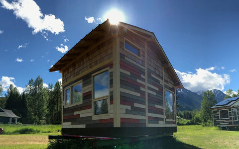 The red tiny house on a beautiful sunny day