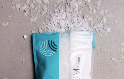 A bag of Amazing Oils Magnesium open with some of the flakes spilling out