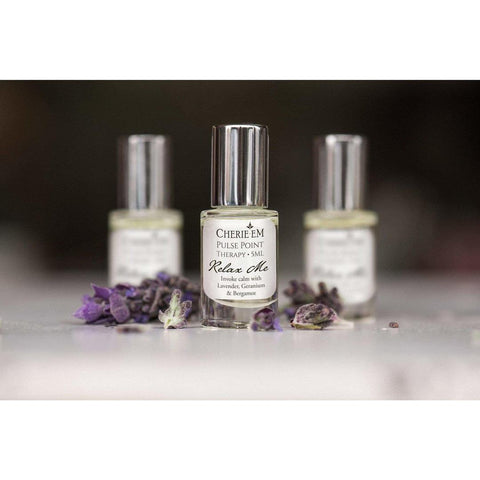 Three small bottles of natural perfume in a row with the scent 'Relax Me' by Cherie Em