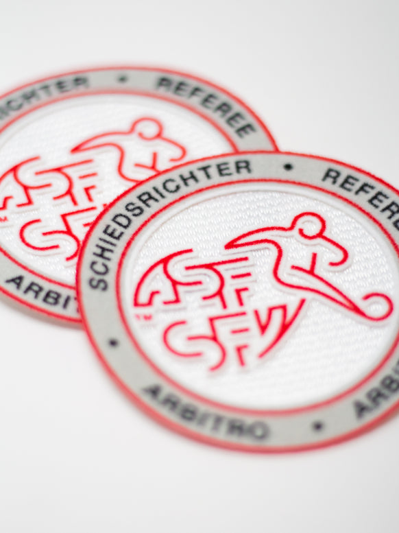 Gewobene Labels und Badges