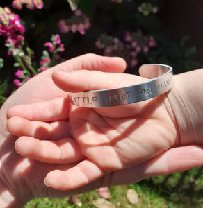 'Your little hand in mine' aluminium bracelet
