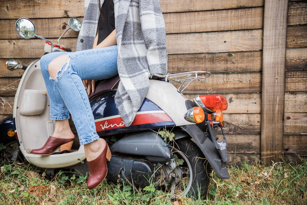 woman on motorcycle wearing abby leather mules