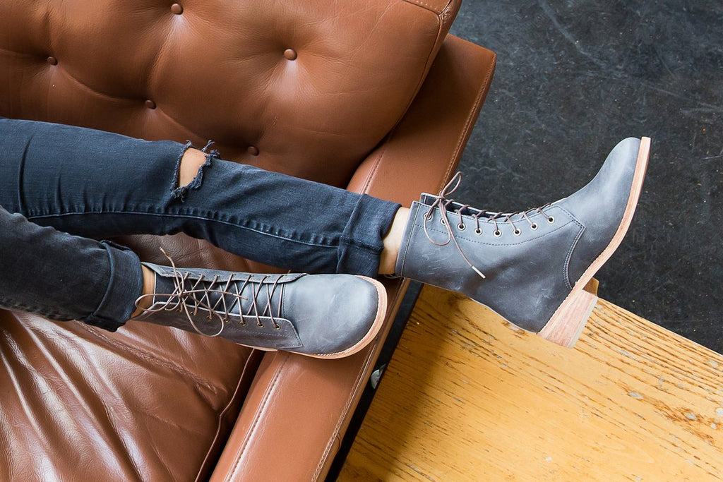 woman on couch wearing leather lace up combat boots