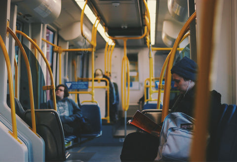 4 sustainable lifestyle goals for the new year - man taking public transportation