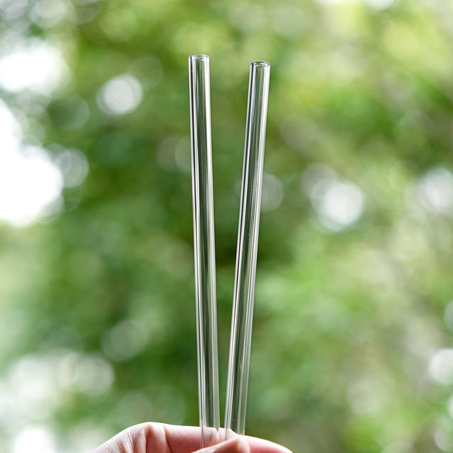 holding 2 bendy glass straws during the day outdoors 8mm wide