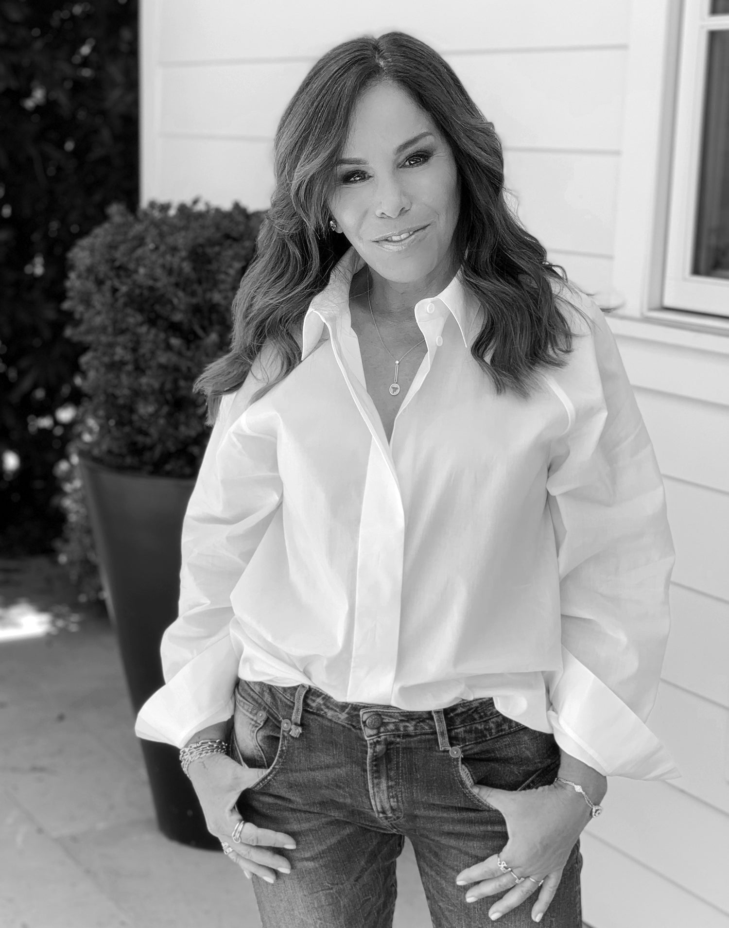 Melissa Rivers wearing white button down and jeans