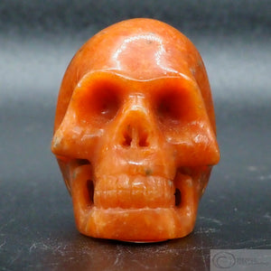 Orange Calcite Human Skull