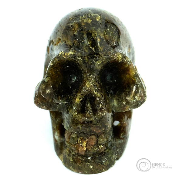 Green and brown small human skull