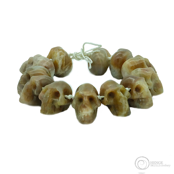 Bracelet with 12 medium sized brown , orange human skull crystals