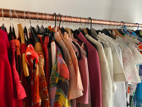Vintage Clothing Hanging off Rail