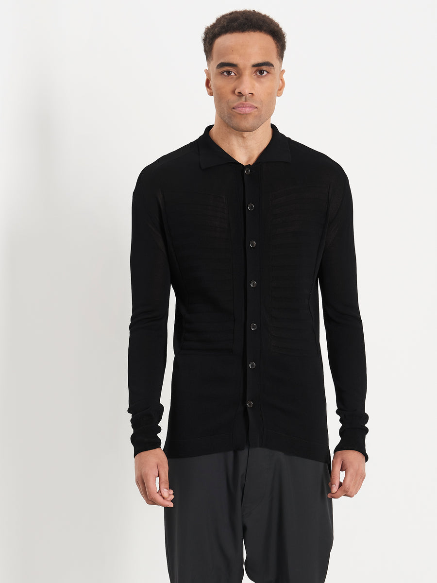 Male model wearing Bib Knitted Polo in Black