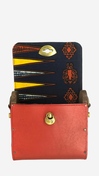 red backpack, Satchel, Clutch,Fanny pack, Cross-body bag) easy changing position, Inspired by Spanish and African Culture SPECS Outer: 100% Spanish Cattle leather Lining: 100% Wax African Print fabric Sides: 100% Pine Wood hand Painted One compartment Vintage Click-plated