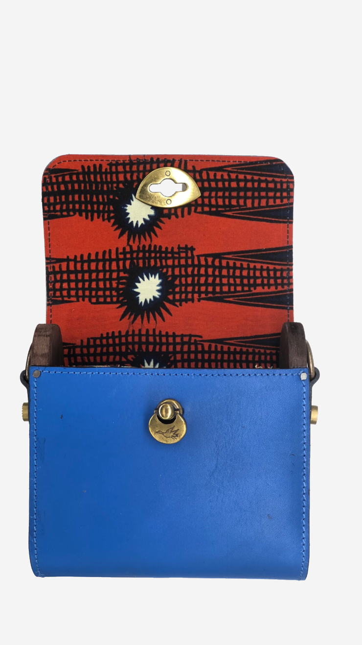 blue backpack, Satchel, Clutch,Fanny pack, Cross-body bag) easy changing position, Inspired by Spanish and African Culture SPECS Outer: 100% Spanish Cattle leather Lining: 100% Wax African Print fabric Sides: 100% Pine Wood hand Painted One compartment Vintage Click-plated