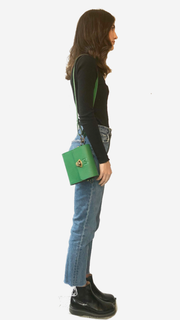 green backpack, Satchel, Clutch,Fanny pack, Cross-body bag) easy changing position, Inspired by Spanish and African Culture SPECS Outer: 100% Spanish Cattle leather Lining: 100% Wax African Print fabric Sides: 100% Pine Wood hand Painted One compartment Vintage Click-plated