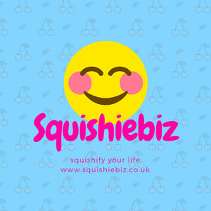 Yellow smiley squishy on a blue cherry background with squishiebiz written over it.