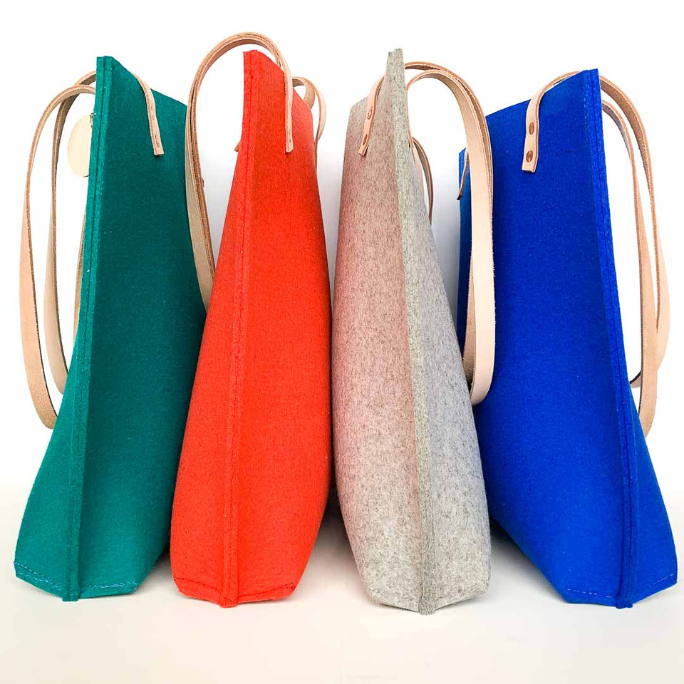 Jenny totes in four colours - teal, mango, concrete grey and royal blue