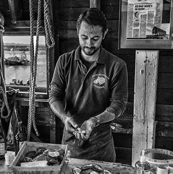 Tom Haward. Mersea Island shucking mersea oysters