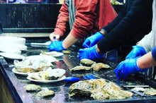 Load image into Gallery viewer, Oysters being opened in Borough Market.
