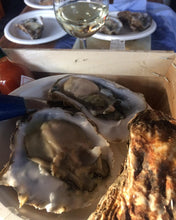 Load image into Gallery viewer, Opened rock and native oysters, served with wine. Square handled oyster knife is sitting next to opened oyster.
