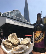 Load image into Gallery viewer, Fresh oysters and beer at Borough Market