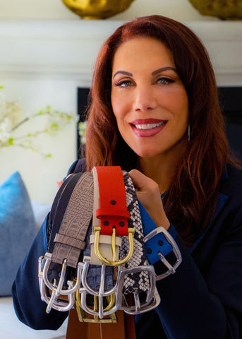 Lynn Taylor, Founder of Behind The Buckle Holding Multiple Belts