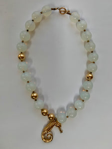 Vintage beaded necklace: gold painted beads and sea horse