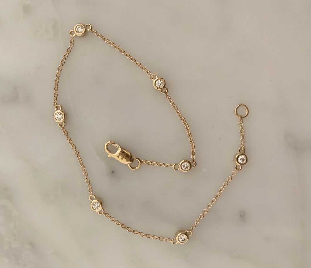 14k gold seven diamond station bracelet