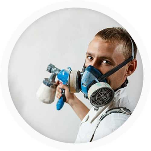 man painting with a spray gun