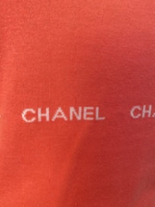 "Vintage Chanel 04P, 2004 Spring Peach/Salmon Sleeveless sweater w/ ""Chanel""  8 times in the design  FR 42 US 8"