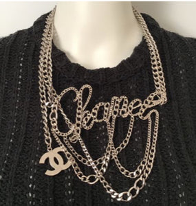 Rare Chanel cursive belt/necklace being worn as a Chanel necklace.