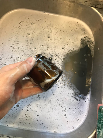 Washing out candle jar