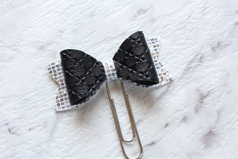 Black and silver planner bow clip