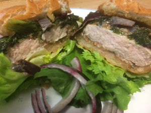 Rosemary and garlic breaded pork chop sandwich