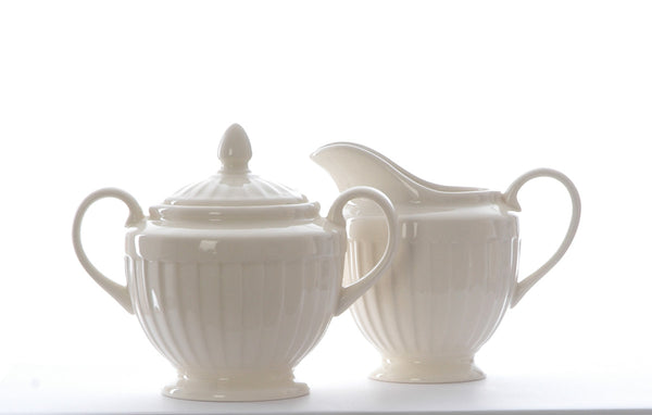 Cream ironstone matching milk jug and sugar bowl