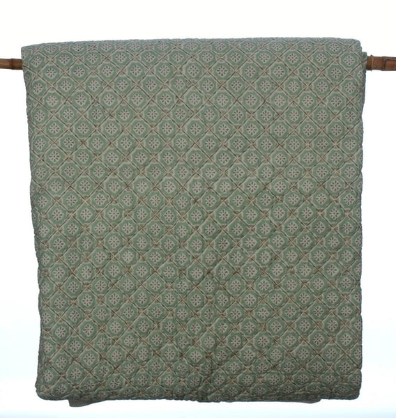 Hand block printed cotton quilt in pale sea green