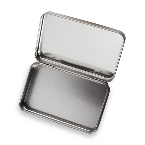open metal tin by field kits for bushcrafters