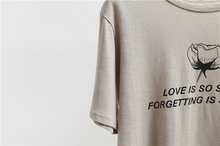 "Load image into Gallery viewer, ""LOVE IS SO SHORT / FORGETTING IS SO LONG"" SHIRT (2 COLORS)"