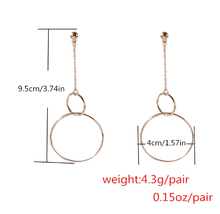 "Load image into Gallery viewer, ""CYBER O-RING"" EARRINGS (2 COLORS)"