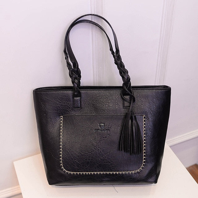 large black braided shoulder bag