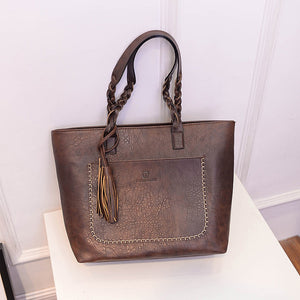 Leather tassel hand bag