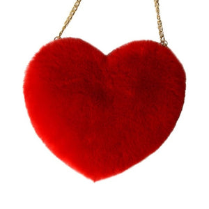 red heart shaped faux fur hand bag