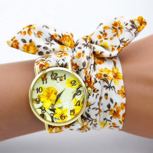brown and yellow floral watch