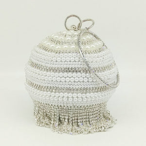 egg shaped clutch with tassels