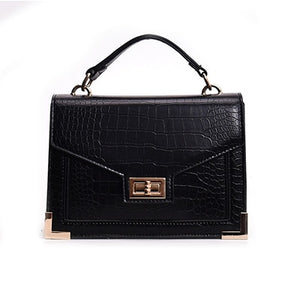 women's black crocodile hand bag