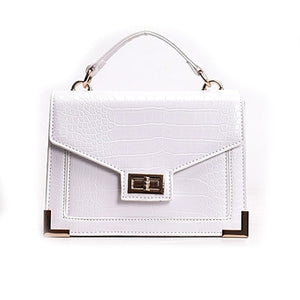 white crocodile hand bag