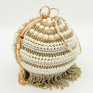 Tan tasseled egg shaped clutch bag