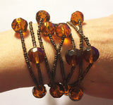Long Necklace of Cut Glass Amber Beads & Copper-Tone Seed Beads
