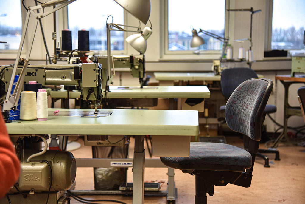 A clothing atelier with sewing machines and lamps, empty